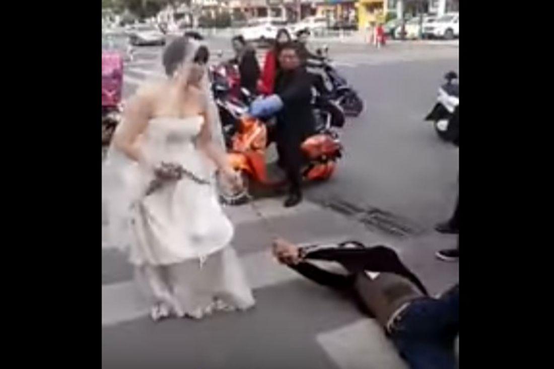Разгневанная невеста протащила своего жениха поулице нацепях